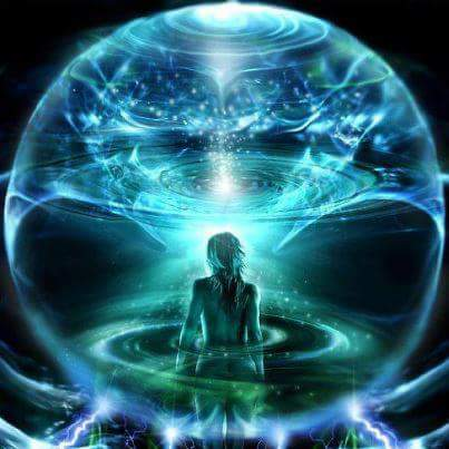 Woman standing with white, blue and green light energy moving around her and encircling her.